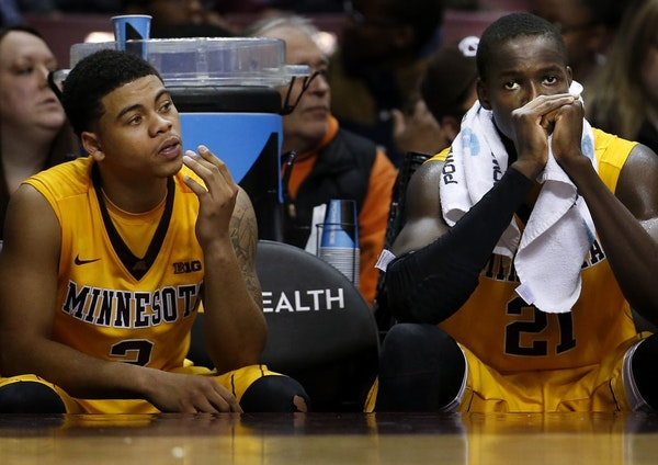 Nate Mason (2) and Bakary Konate (21) watched from the bench in the final second of the game. Milwaukee beat Minnesota by a final score of 74-65.