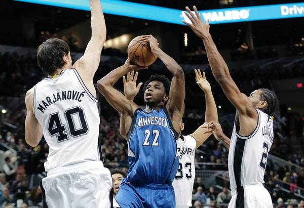 Timberwolves guard Andrew Wiggins shot over Spurs center Boban Marjanovic during the first half Monday night.