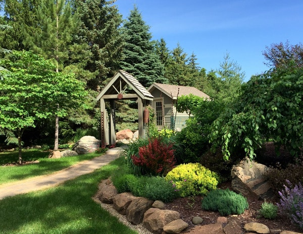 The couple decided to keep their existing trees, shrubs and plants — then rearrange them to complement the new house.