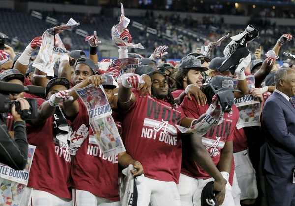 Alabama celebrates after the Cotton Bowl NCAA college football semifinal playoff game against Michigan State, Thursday, Dec. 31, 2015, in Arlington, T