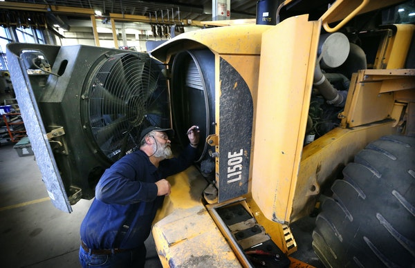 Dale Cannon inspected the radiator of a piece of Minneapolis Public Works heavy equipment that was sitting idle on an unseasonally dry day Thursday.
