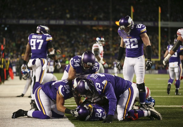 Vikings cornerback Captain Munnerlyn (24) was congratulated by his teammates after he intercepted a pass in the third quarter and returned it 32 yards