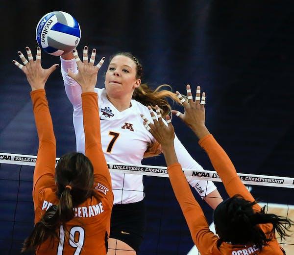 Minnesota's Hannah Tapp (7) spikes the ball against Texas' Paulina Prieto Cerame (19) and Chiaka Ogbogu (11) during an NCAA women's volleyball tournam