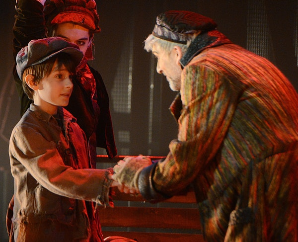 """Fagin, played by Bradley Greenwald, speaks to Oliver, played by Nate Turcotte, during a rehearsal of """"Oliver!"""". ] PHOTO SPECIAL TO THE STAR TRIBUNE BR"""