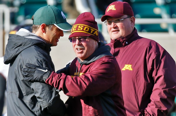 Jerry Kill, center, and Tracy Claeys will share the Gophers' coaching bonus for reaching a bowl game this season. Kill retired after seven games due t