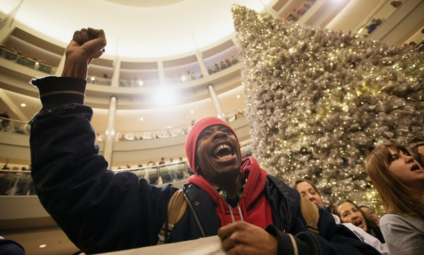 A year ago: In this Dec. 20, 2014, photo, Janerio Taylor, of Minneapolis, chants with other demonstrators during a Black Lives Matter protest at the M