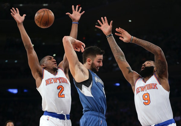Timberwolves guard Ricky Rubio passed behind his head against Knicks guard Langston Galloway (2) and forward Kyle O'Quinn (9) during the first quarter