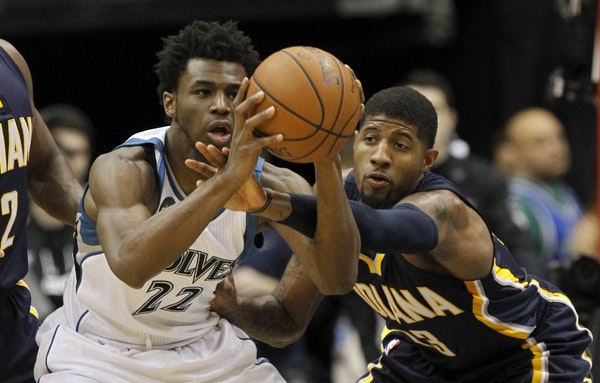 Wolves guard Andrew Wiggins looked to pass to a teammate under pressure from Pacers star Paul George on Saturday.