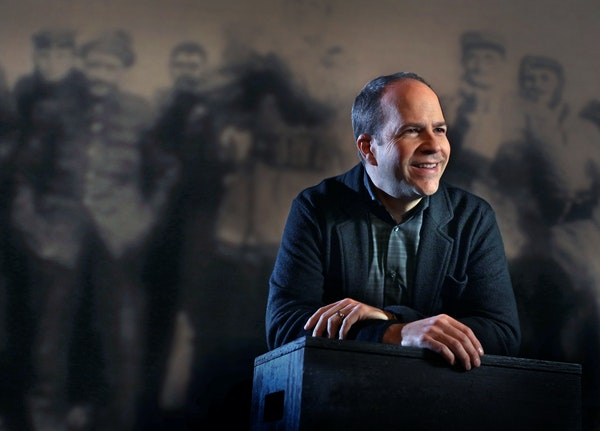 """Peter Rothstein at a rehearsal of """"All Is Calm: The Christmas Truce of 1914"""" at the Pantages Theatre in downtown Minneapolis."""