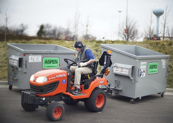 Bobby Johnson drove around two recycling bins while completing chores at One South Place.