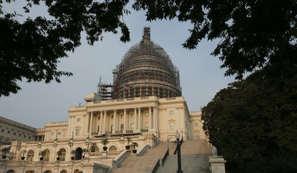 The west front of the U.S. Capitol is seen under repair Sept. 2, 2015 in Washington. In the waning days before the Christmas recess, both chambers of