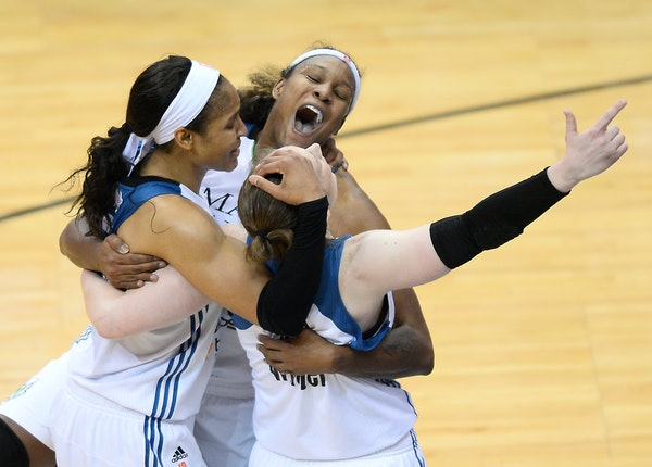 From left, Minnesota Lynx forward Maya Moore (23), forward Rebekkah Brunson (32) and guard Lindsay Whalen (13) celebrated after defeating Indiana in t