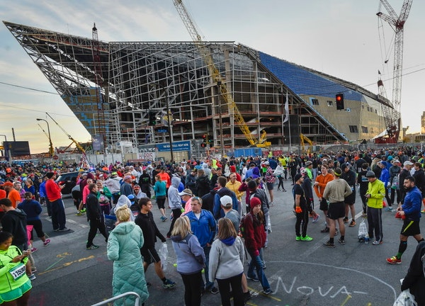 Runners and others gathered near the U.S. Bank Stadium construction site before the start of the Twin Cities Marathon in Minneapolis on Sunday.