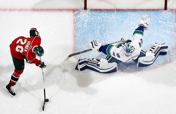Wild winger Thomas Vanek prepared to shoot the puck past Canucks goalie Ryan Miller (30) for a goal in the first period Tuesday.