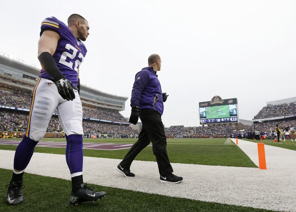 Vikings safety Harrison Smith walked back onto the sidelines in the second quarter after leaving the game because of an injury in the first quarter.