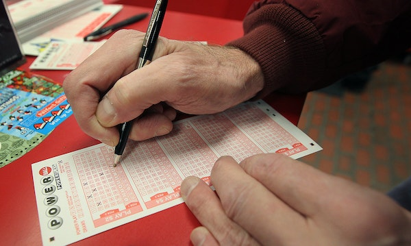 Kevin Hughes filled out a Powerball ticket Friday for purchase at a Northeast Minneapolis Super America.