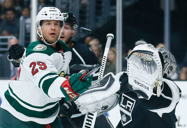 Minnesota Wild right wing Jason Pominville, left, eyes the puck as he tries to score past Los Angeles Kings goalie Jonathan Quick last season.