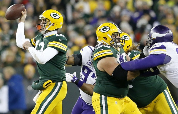 Everson Griffen (97) sacked Aaron Rodgers (12) forcing a fumble that was picked up by Captain Munnerlyn and returned for a touchdown in the third quar