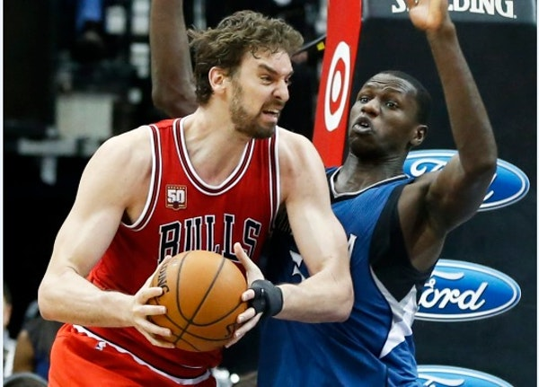 Chicago Bulls' Pau Gasol, left, of Spain, tries to work around Minnesota Timberwolves' Gorgui Dieng of Senegal in the second half of an NBA basket