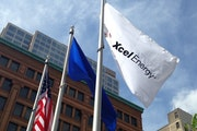 Rate hikes in several areas offset lower electric and natural gas demand during the last three months of the year for Xcel Energy.