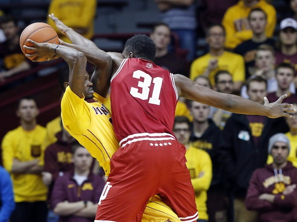Indiana's Thomas Bryant, right, defends against Minnesota's Carlos Morris in the first half of an NCAA college basketball game, Saturday, Jan. 16, 2