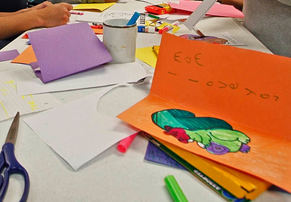 Students work on Valentine's Day cards at school in this file photo.
