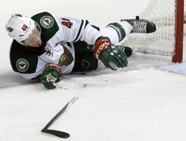 Wild defenseman Jared Spurgeon took a stick to face from the Stars' Tyler Seguin during the third period Saturday. No penalty was called, and Spurge