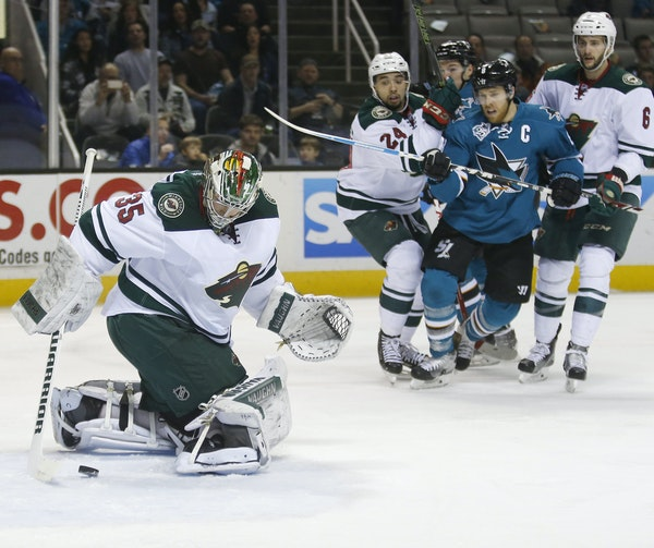 Wild goalie Darcy Kuemper used his stick to stop a puck that had gotten past him early in Saturday afternoon's game against the San Jose Sharks. The