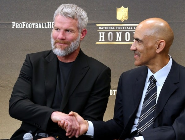 Former NFL players Brett Favre, left, and Tony Dungy, who will be inducted into the Pro Football Hall of Fame class of 2016, speak in the Hall of Fame