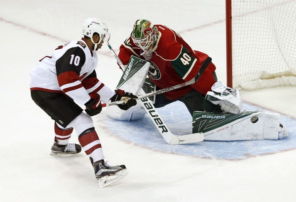 Anthony Duclair scores the decisive goal in a shoot against Minnesota Wild goalie Devan Dubnyk in the third period of an NHL hockey game, Monday, Jan.