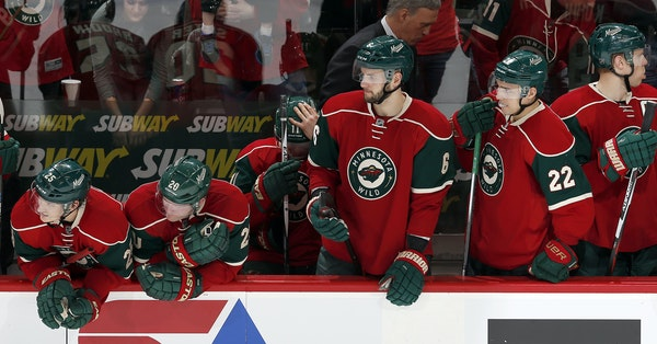 Wild players watched as the Coyotes won a shootout Monday night at the Xcel Energy Center.