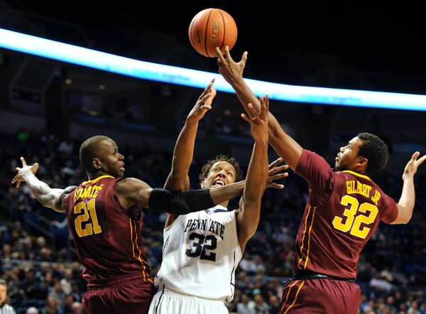 Penn State's Jordan Dickerson (32) fights for the ball with Minnesota's Bakary Konate (21) and Ahmad Gilbert (32) at the Bryce Jordan Center in Univer