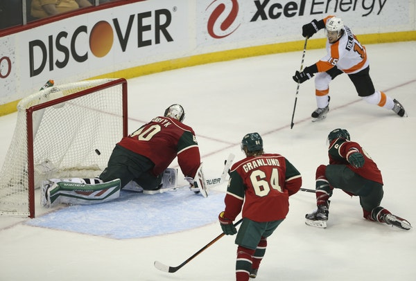 Philadelphia Flyers defenseman Michael Del Zotto (15) slipped the puck between Wild goalie Devan Dubnyk and the pipe for the game-winning goal in the