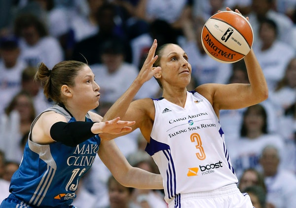 Phoenix Mercury's Diana Taurasi tries to keep the ball away from Minnesota Lynx's Lindsay Whalen during the first half in Game 1 of the WNBA Western C