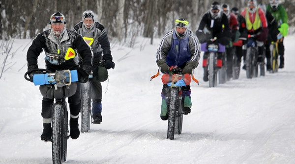 Cyclists brave the conditions and the terrain at the Arrowhead 135 Ultramarathon.