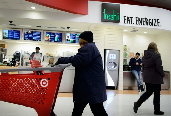 Shoppers pass the new Freshii restaurant at the Target store on New Brighton Blvd. in Minneapolis.