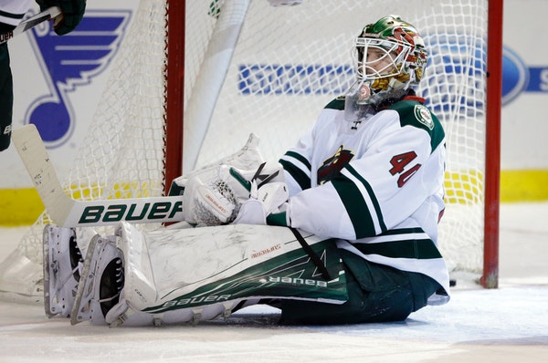 Minnesota Wild goalie Devan Dubnyk sits on the ice after giving up a goal to St. Louis Blues' Jori Lehtera, of Finland, during the second period of an