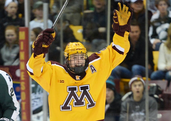 Michigan State Spartans forward Villiam Haag (26) looked on as Minnesota Golden Gophers left wing Connor Reilly (21) celebrated his goal to put the Go