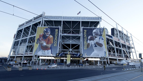Banners featuring Denver's Peyton Manning and Carolina's Cam Newton hang outside Levi's Stadium, the site of Sunday's Super Bowl in Santa Clar