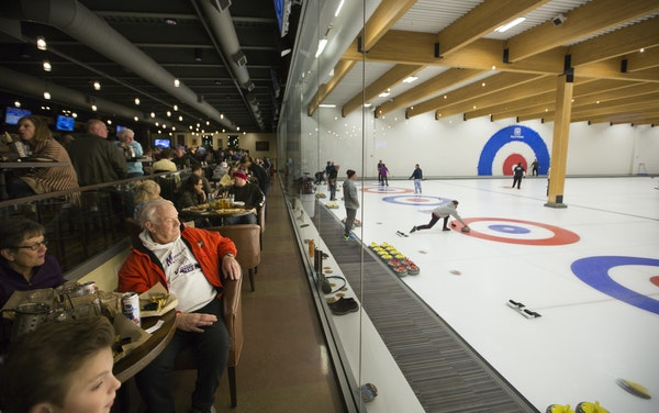 Joanne and Jim Johnson watched a curling match during a birthday dinner with grandsons Lincoln and Davis Johnson at the Chaska Curling Center.