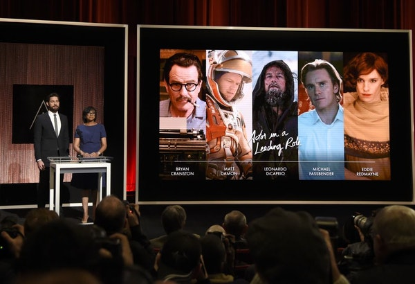 FILE - In this Jan. 14, 2016 file photo, John Krasinski, left, and Academy President Cheryl Boone Isaacs announce the Academy Awards nominations for b