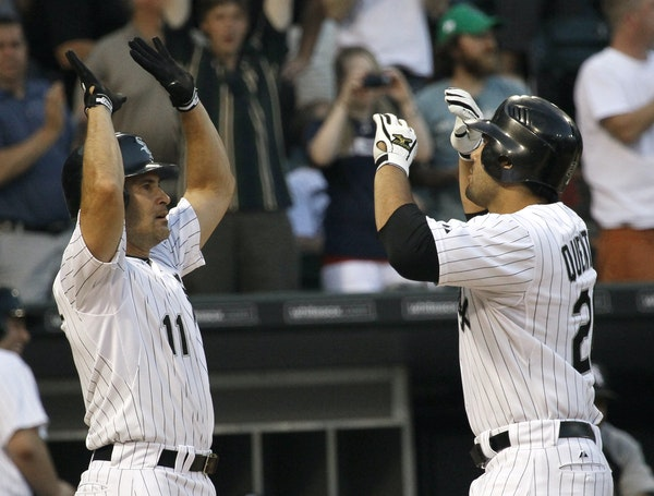 Carlos Quentin, right, celebrated after hitting a home run for the White Sox in 2011. Now the Twins have signed the former two-time All-Star.