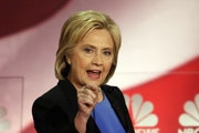Presidential candidate Hillary Clinton, seen at Sunday's debate in South Carolina, has praised Minnesota's student debt relief plan.