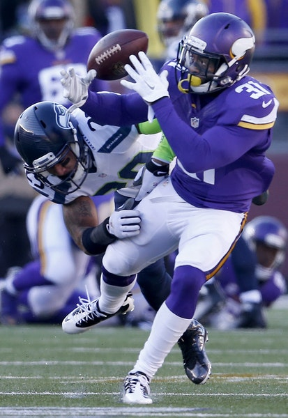Safety Earl Thomas broke up a pass — a perfect ball thrown by Teddy Bridgewater that traveled 22 yards to Jerick McKinnon (31) — early in the seco