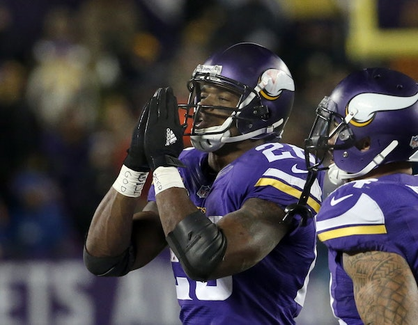 Minnesota Vikings running back Adrian Peterson, left, gestures after his touchdown during the second half of an NFL football game against the New York