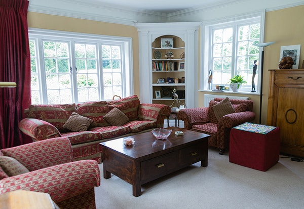 The living room at Nettlepole is comfortable and bright.