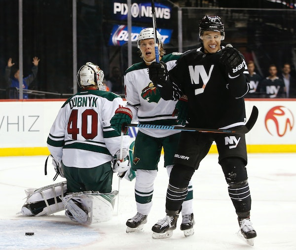 New York Islanders center Anders Lee (27) celebrates after scoring a goal on Minnesota Wild goalie Devan Dubnyk (40) during the second period of an NH