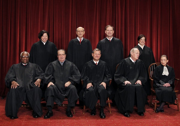 Members of the U.S. Supreme Court, seated, from left are Clarence Thomas, 67; Antonin Scalia, 79; John Roberts, 61; Anthony Kennedy, 79, and Ruth Bade