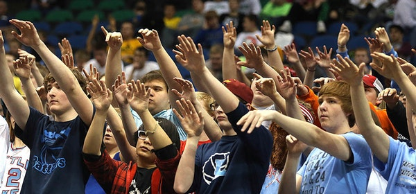 Fans at the Minnesota state boys' basketball team tried to distract an opponent during a free throw. The Wisconsin Interscholastic Athletic Associatio