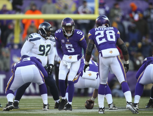Vikings quarterback Teddy Bridgewater gave the play call to Vikings running back Adrian Peterson before the snap in the third quarter.